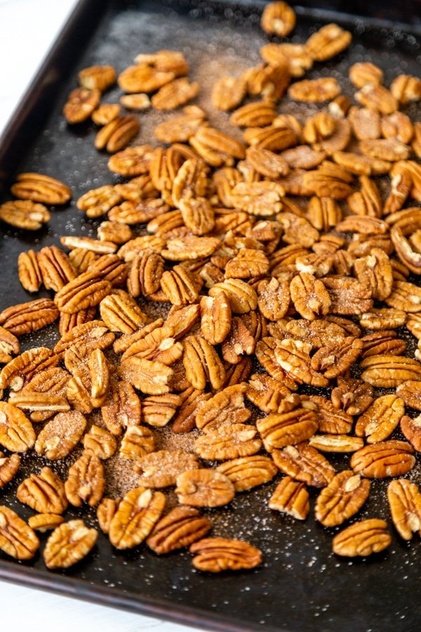 A baking sheet with toasted pecans.