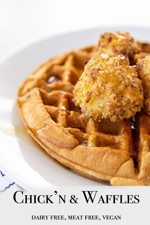 A Pinterest pin for vegan chicken & waffles with a picture of half of a white plate with a Belgian waffle topped with cauliflower chicken and maple syrup.
