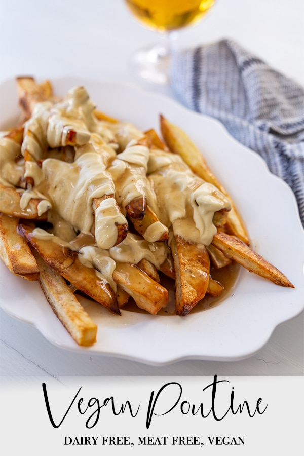 A Pinterest pin for vegan poutine with a picture of a white oval platter of the poutine and a glass of beer.
