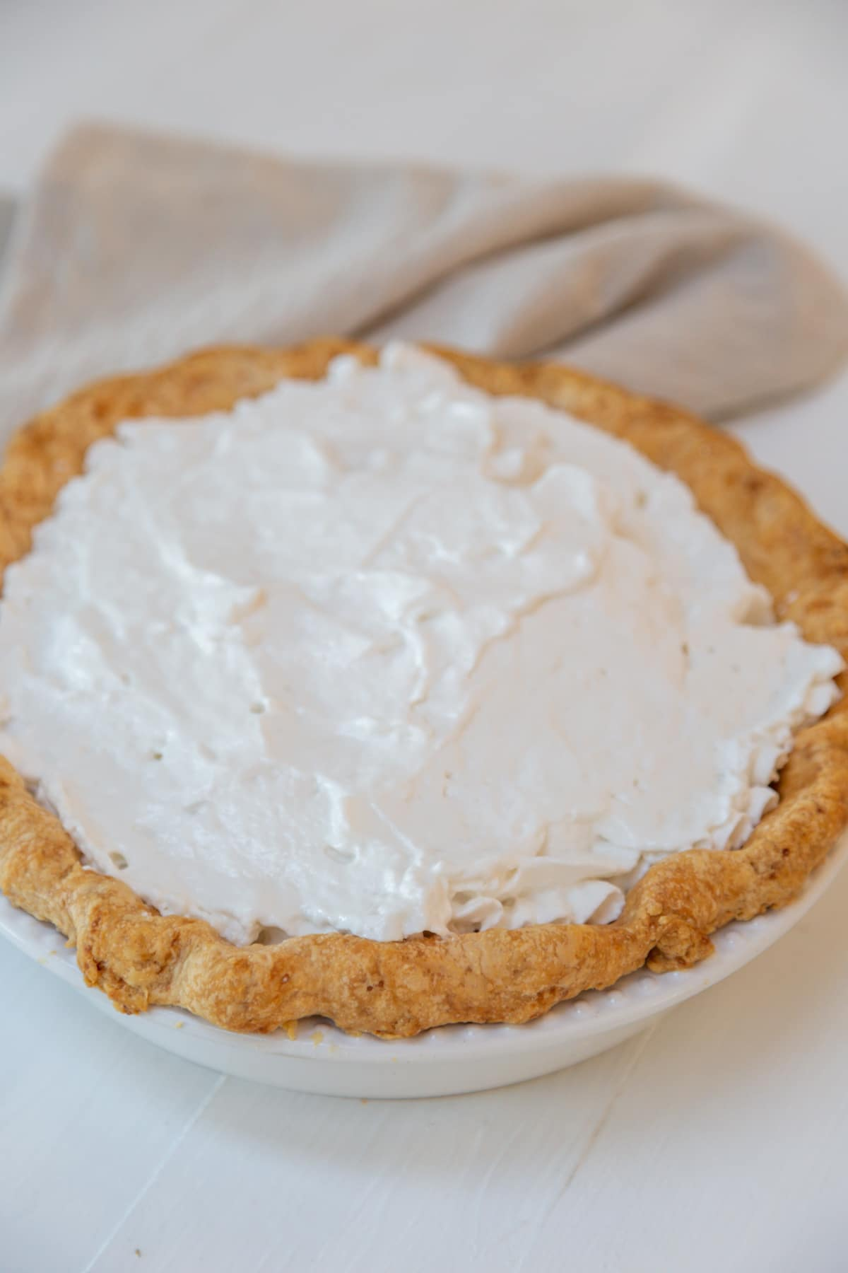 A pie with whipped cream topping.
