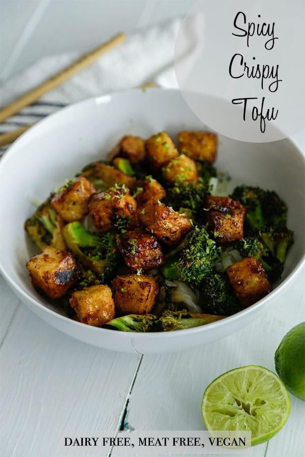 A Pinterest pin for spicy crispy tofu bites with a picture of a white bowl filled with the tofu bites, broccoli, and rice.