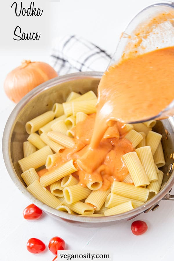 A Pinterest pin for vegan vodka sauce with a picture of the sauce being poured over pasta.