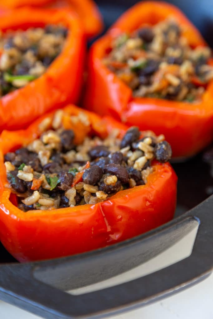 red bell peppers stuffed with beans and rice.