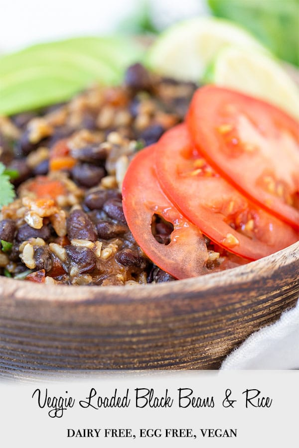 A PInterest pin for veggie loaded black beans and rice with a picture of the recipe in a wooden bowl.