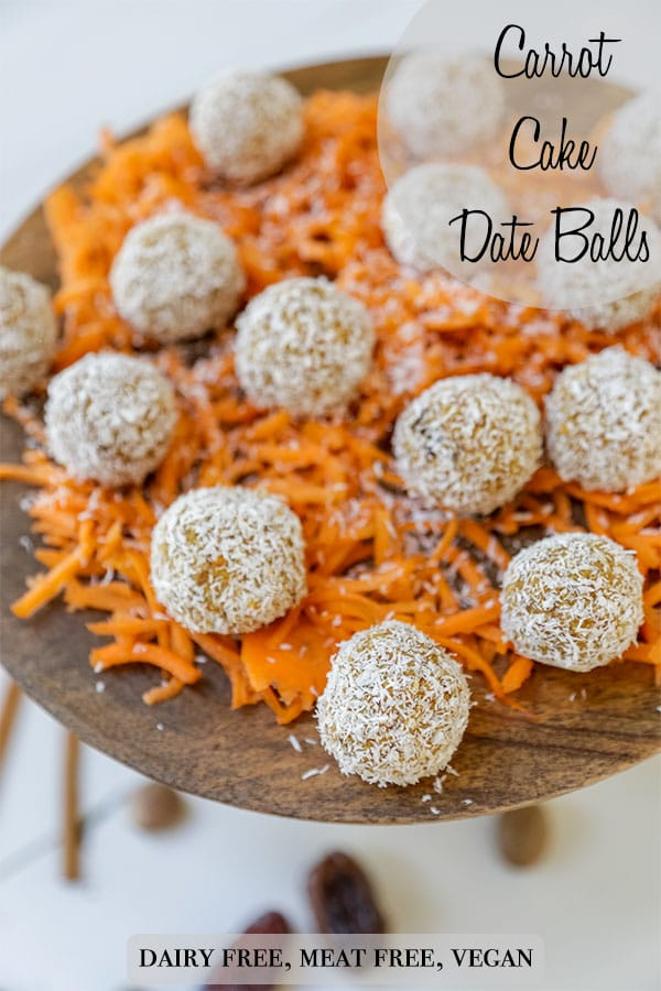 A Pinterest pin for carrot cake bites with a picture of the bites on a layer of shredded carrots on a wood cake stand.