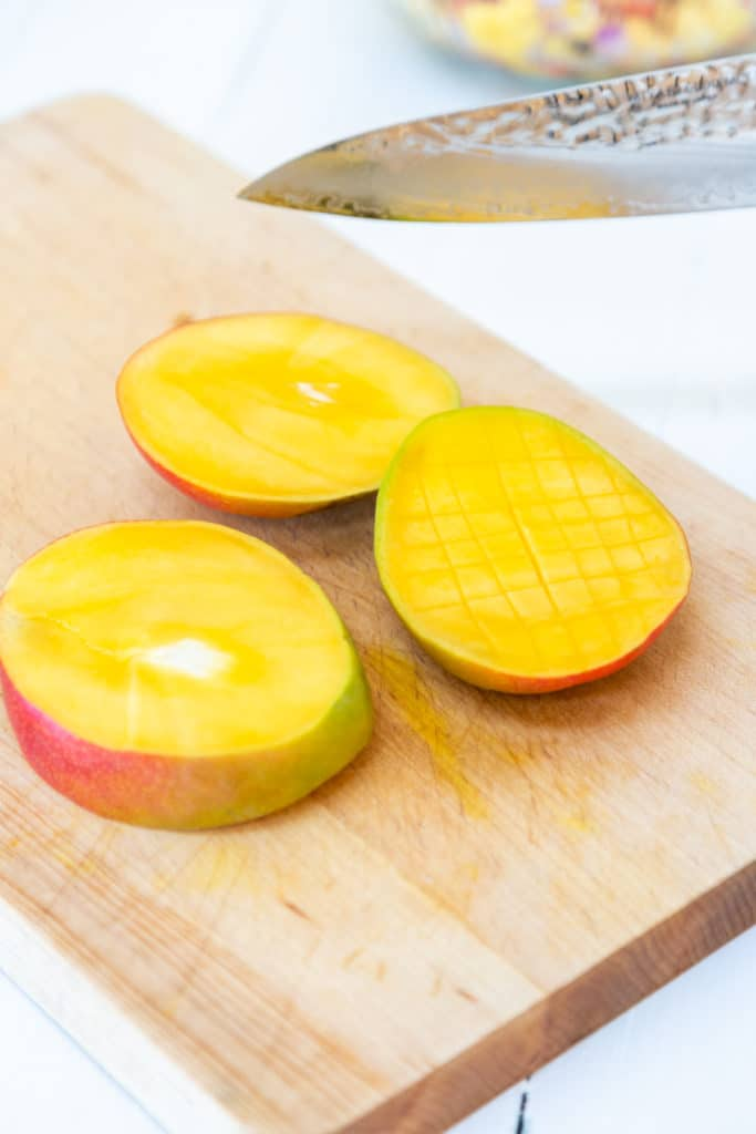 Sliced mango on a wooden board.