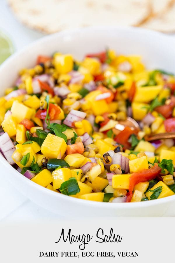 A Pinterest pin for mango salsa with a picture of the salsa in a white bowl.