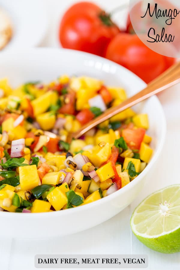 A PInterest pin for mango salsa with a picture of the salsa in a white bowl with a gold spoon.