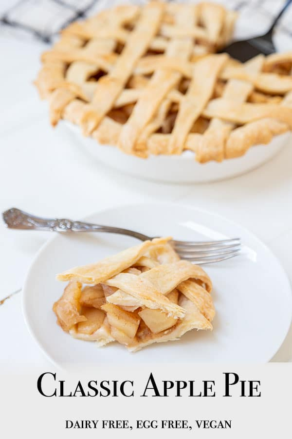 A Pinterest pin for vegan apple pie with a picture of a slice of pie on a white plate and the whole pie with a lattice top in the background.