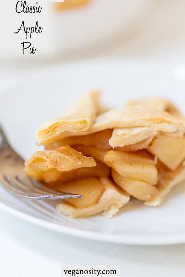 A Pinterest pin for vegan apple pie with a picture of a slice of pie on a white plate.