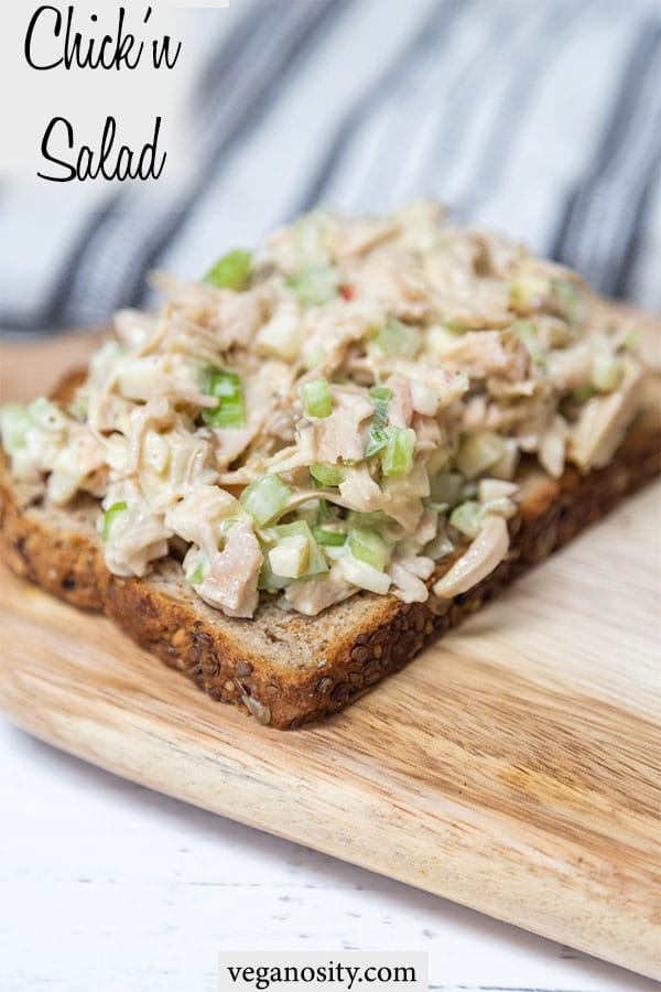A PInterest pin for vegan chicken salad with a picture of the salad on a piece of toast.